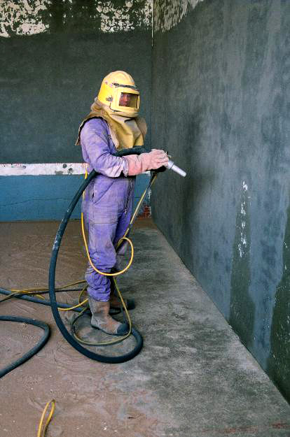 Fives court photo: sand blasting to remove paint