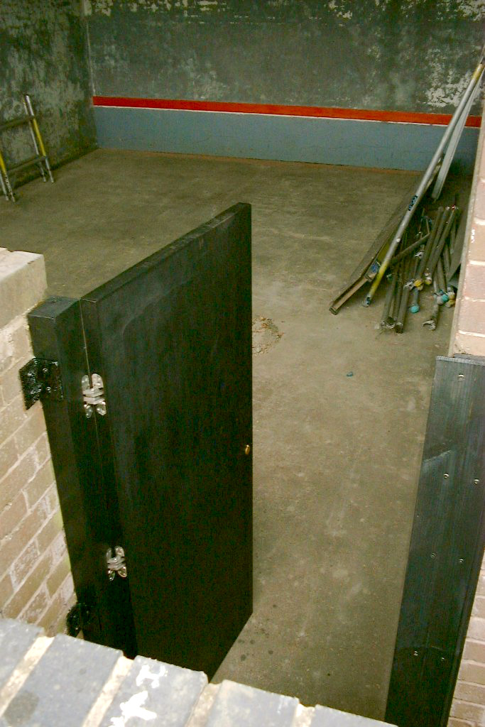 Fives court photo: doors and boards painted