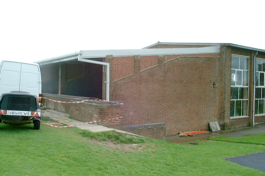 Fives court photo: guttering completed and wall paint removal